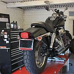 Harley-Davidson on lift in workshop
